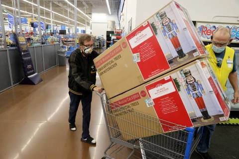 Robert Sachetti, 60, of Las Vegas, rolls out his purchases shortly after the 5 a.m. opening at ...