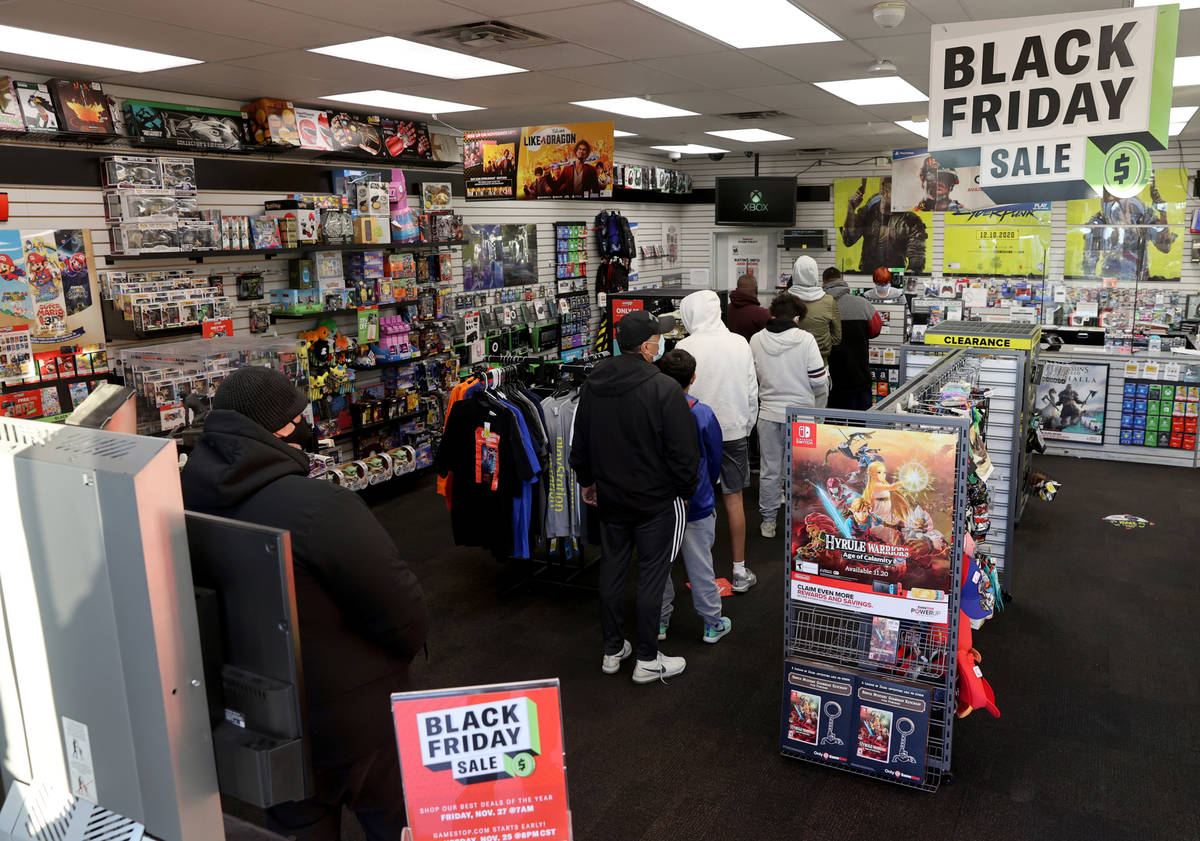 Shoppers line up for Black Friday deals at GameStop on East Tropicana Avenue at McLeod Drive in ...