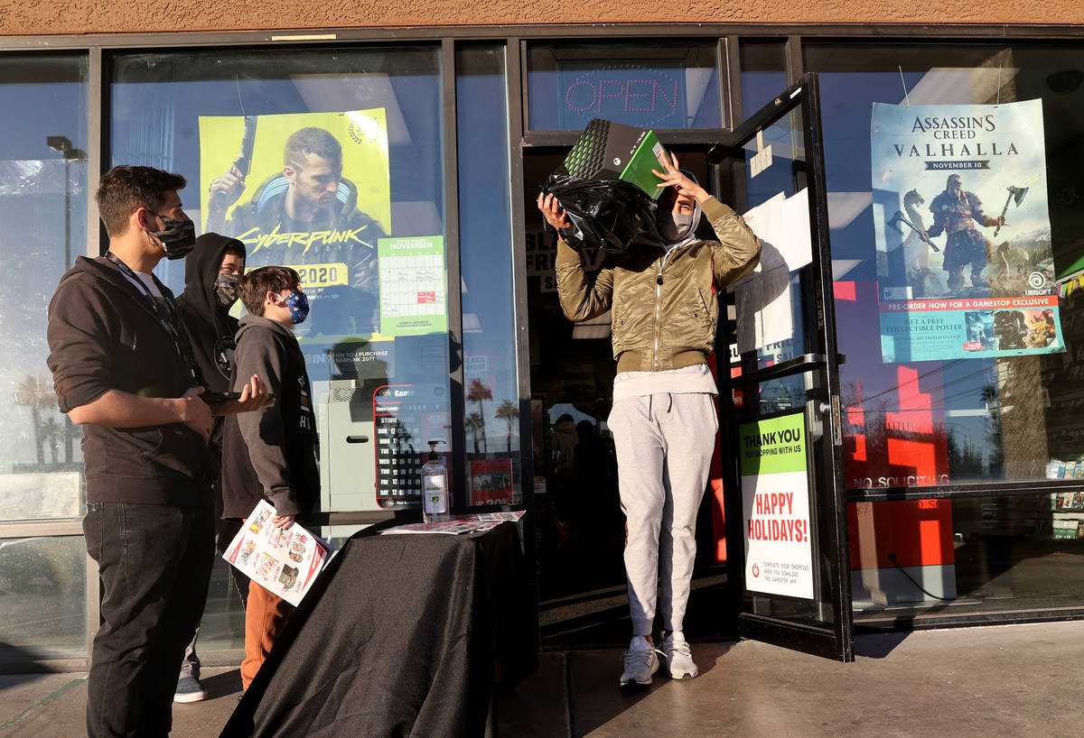 Mo Khould, 17, walks out with the first Xbox Series X system shortly after the 7 a.m. opening o ...