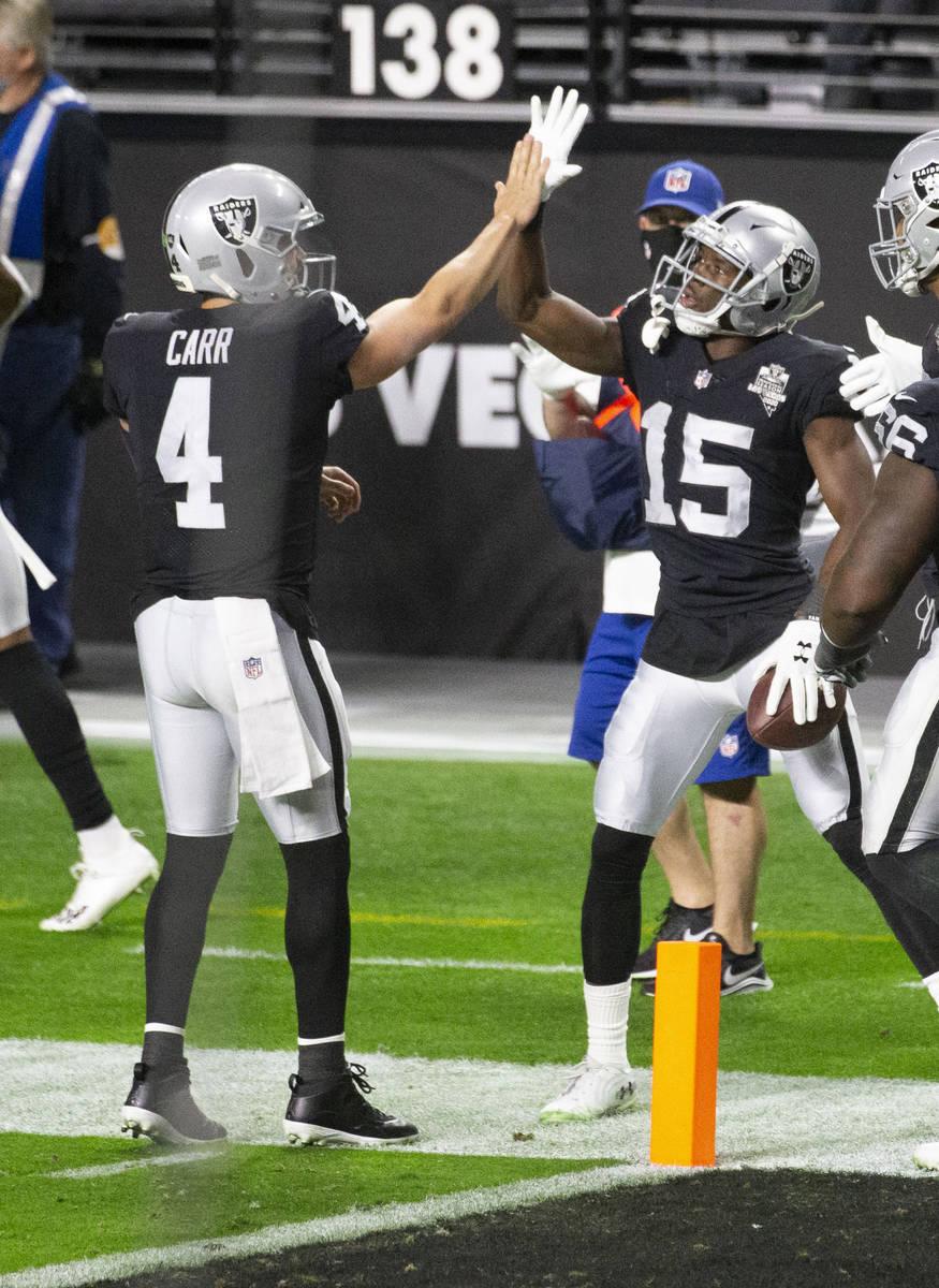 Las Vegas Raiders wide receiver Nelson Agholor (15) celebrates his touchdown score with quarter ...