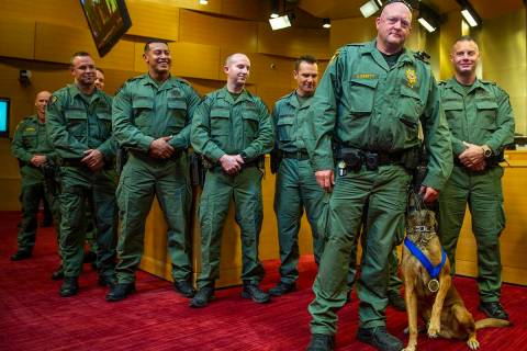 Las Vegas police K-9 officer Jeff Corbett with his dog Hunter are flanked by other officers whi ...