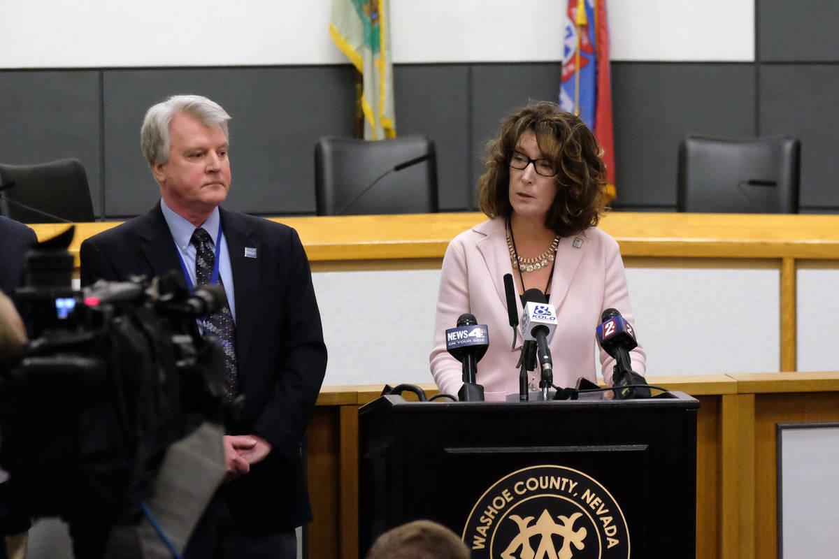 Interim Washoe County schools Superintendent Kristen McNeill, at right, speaks to reporters Fri ...