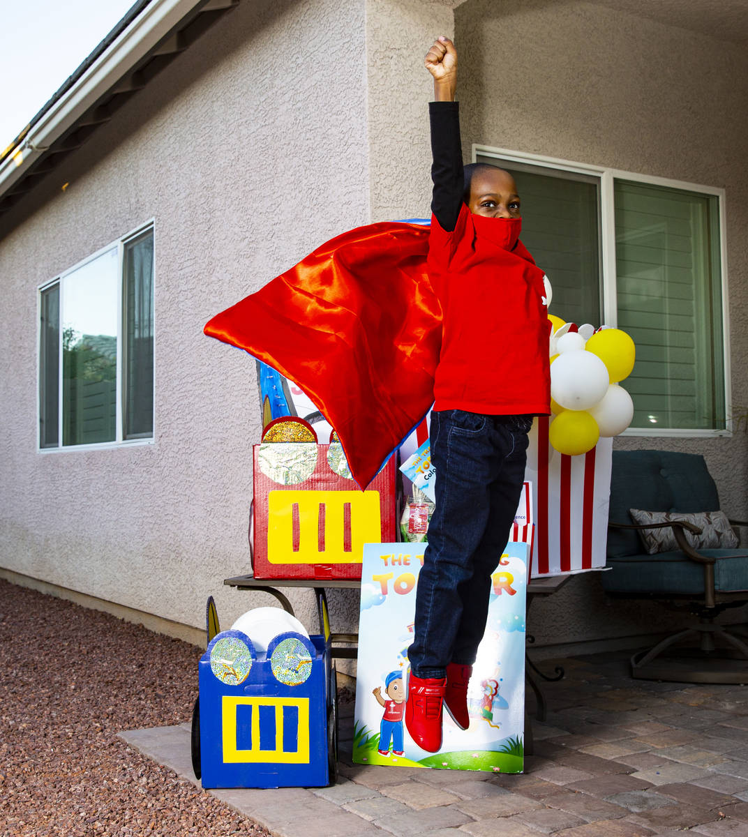 Five-year-old Justyn Boumah, who led a read-a-thon fundraiser, poses for a portrait at his home ...