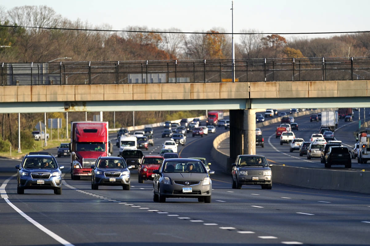 Vehicles travel westbound on Interstate 695, Tuesday, Nov. 24, 2020, in Parkville, Md. (AP Phot ...