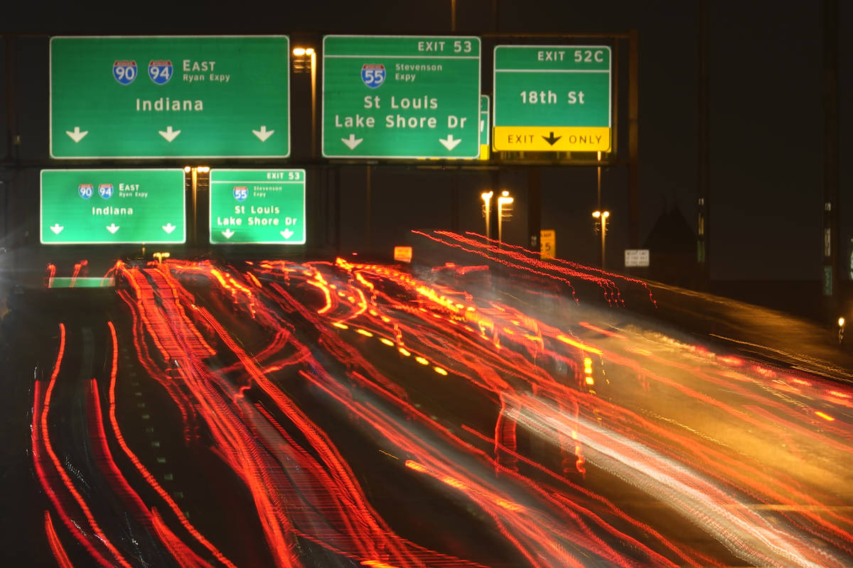 Motorists travel south Tuesday, Nov. 24, 2020, along Interstates 90 and 94 in Chicago. (AP Phot ...