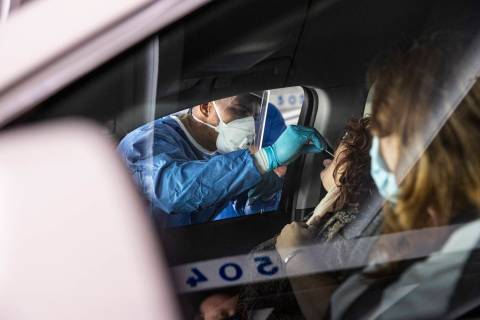Nevada National Guard Spc. Demetrie Barnett takes a swab sample from Vanessa Aguayo-Barker to t ...