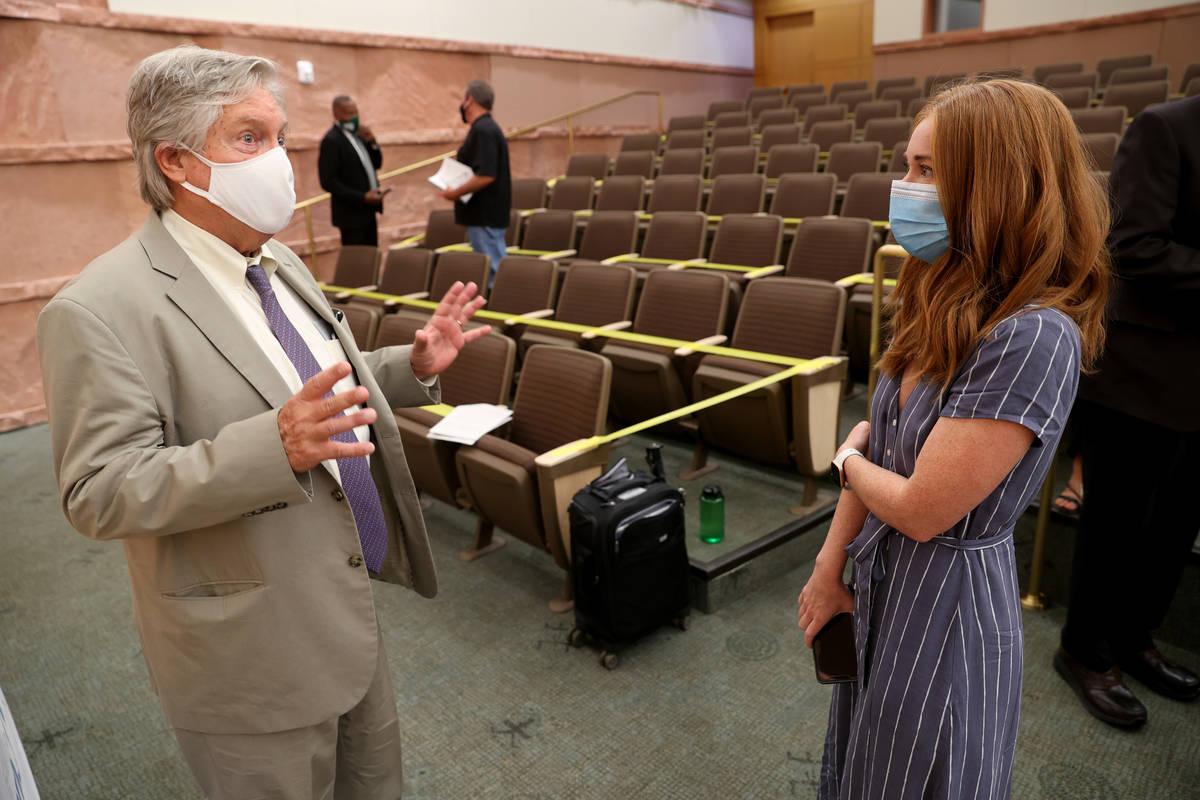 Kristen Corral, owner of Tacotarian restaurant, talks to Clark County Commissioner Tick Segerbl ...