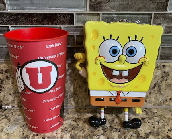 In this photo provided by Utah sports writer Andy Larsen are a childhood piggybank, right, and ...