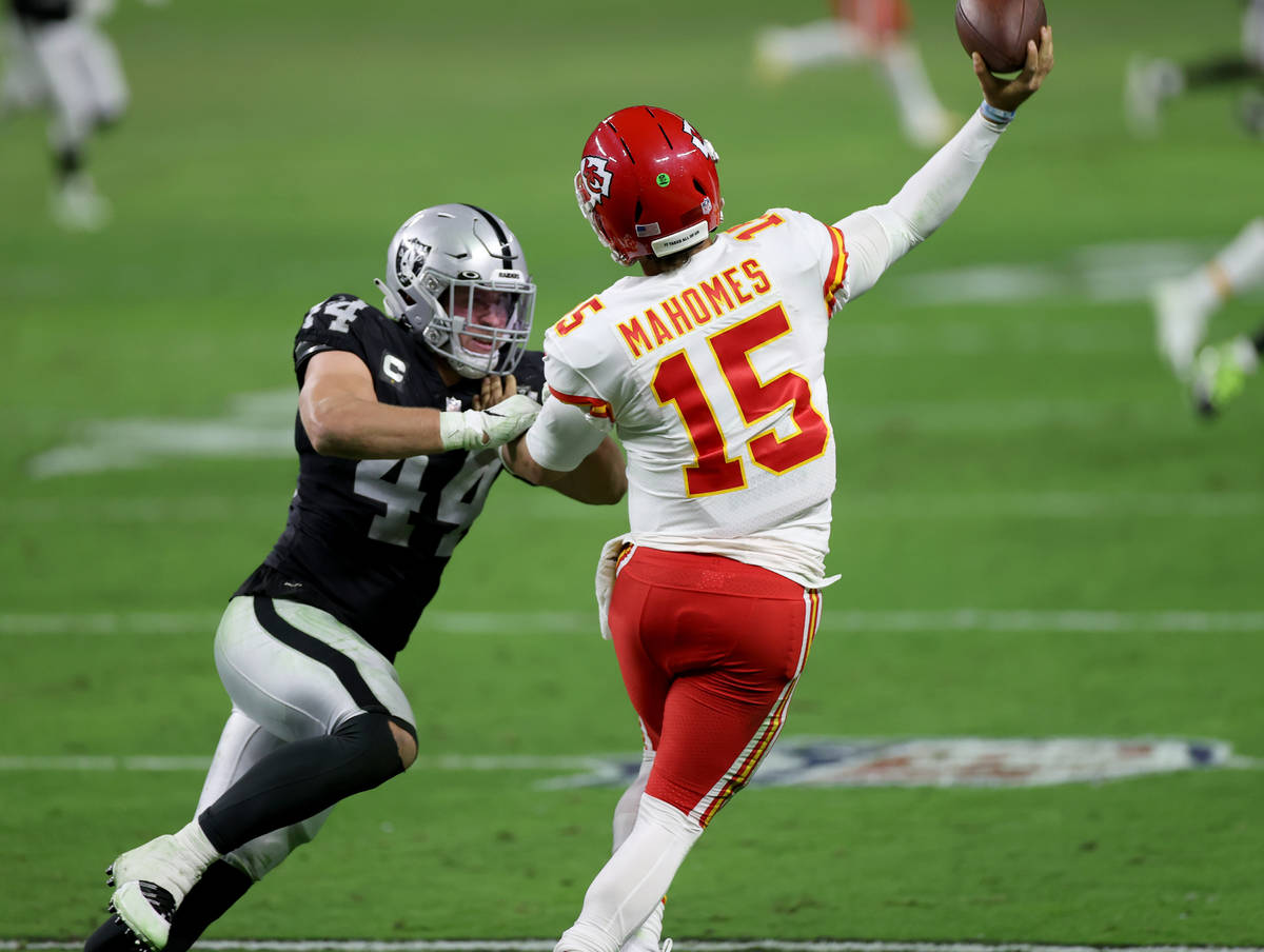 Kansas City Chiefs quarterback Patrick Mahomes (15) throws under pressure from Las Vegas Raider ...