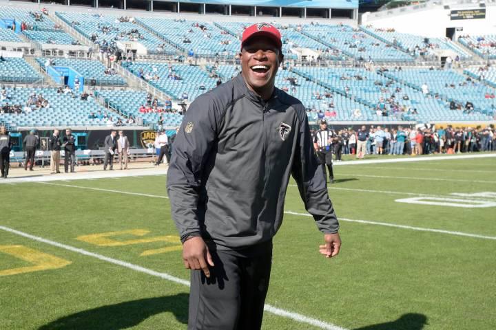 Atlanta Falcons assistant head coach Raheem Morris watches warmups before an NFL football game ...