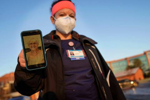 Nurse Jessica Franz, shows a photo of her mother-in-law, Elaine Franz, outside Olathe Medical C ...
