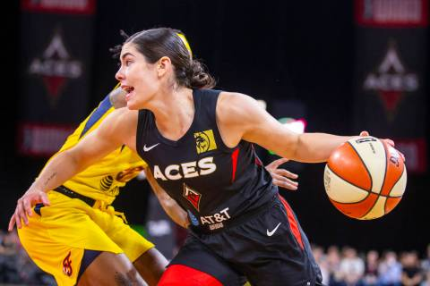 Las Vegas Aces guard Kelsey Plum (10) drives past an Indiana Fever defender to the basket durin ...