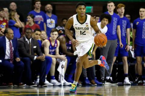 FILE - Baylor guard Jared Butler dribbles up court against Kansas during an NCAA college basket ...