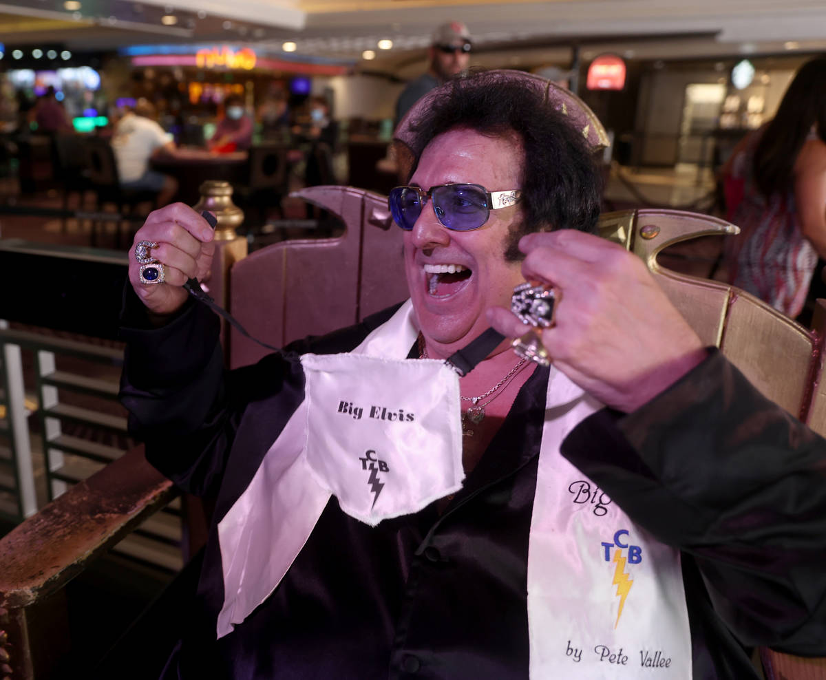 "Pete ""Big Elvis"" Vallee shows his face mask between sets performing at the Piano Bar ..."