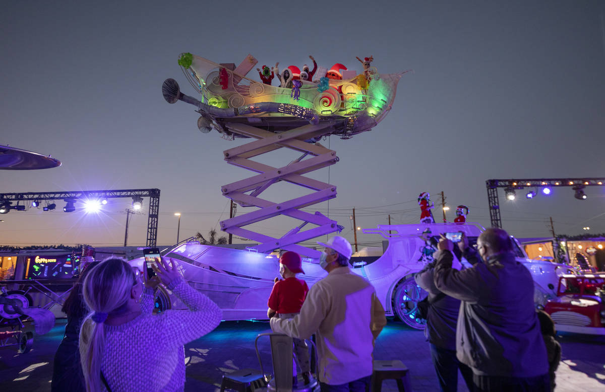"""Toys are thrown to kids from a sleigh during the kick off of """"Wanderland"""" holiday experience at ..."""