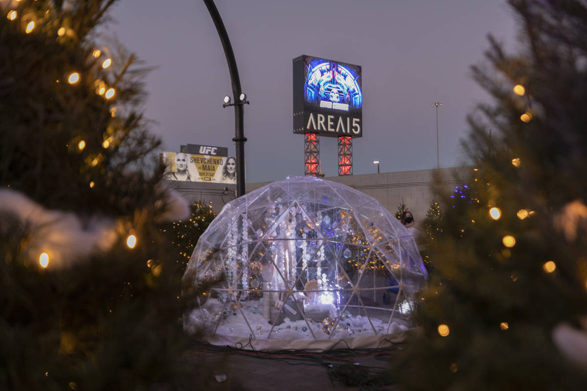 """Lit trees surround igloos during the kick off of """"Wanderland"""" holiday experience at Area15 on F ..."""