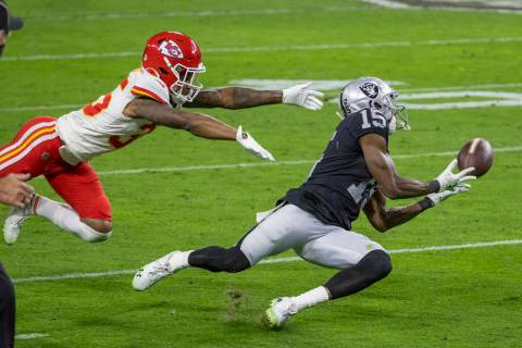 Las Vegas Raiders wide receiver Nelson Agholor (15) makes a diving attempt at a long pass as Ka ...
