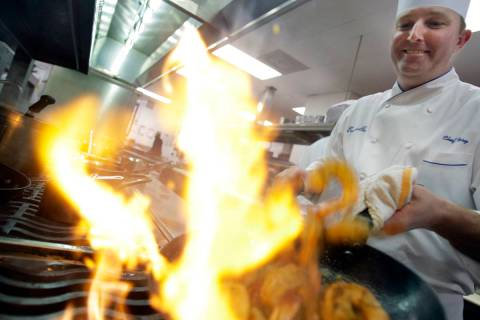 In this Wednesday, Jan. 7, 2009 file photo, Executive Chef Tory McPhail cooks Lemon and Garlic ...