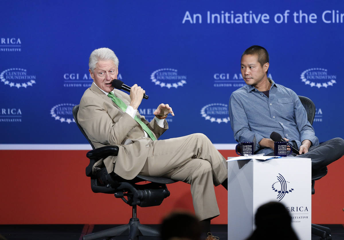 In this June 25, 2014, file photo, former President Bill Clinton, left, speaks with Zappos CEO ...