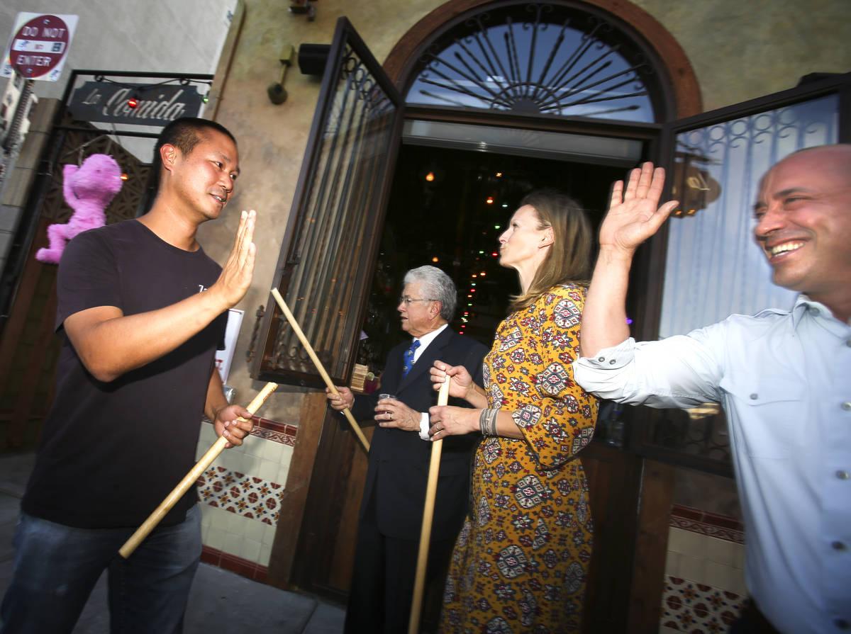 Zappos C.E.O. and downtown Las Vegas developer Tony Hsieh, left, high fives La Comida co-owner ...