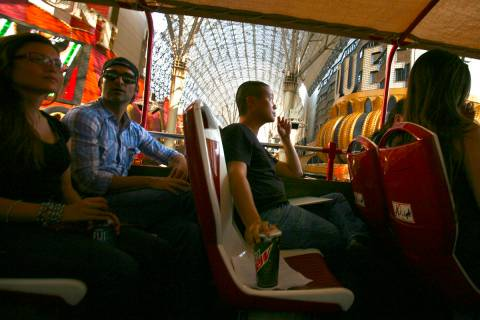 Tony Hsieh, center,CEO of of online clothing maker Zappos.com, during Big Bus downtown tour, T ...