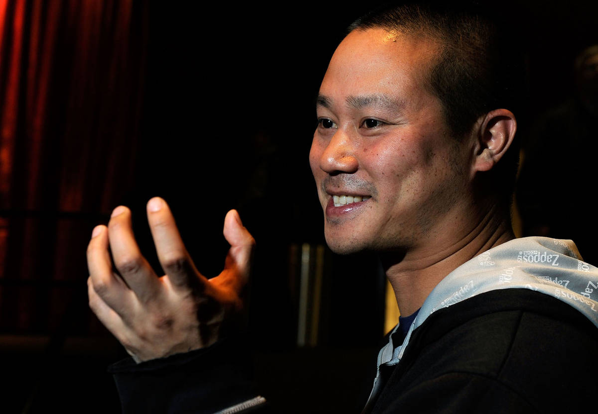Zappos CEO Tony Hsieh gestures during an interview before the srtart of the LaunchUp Las Vegas ...