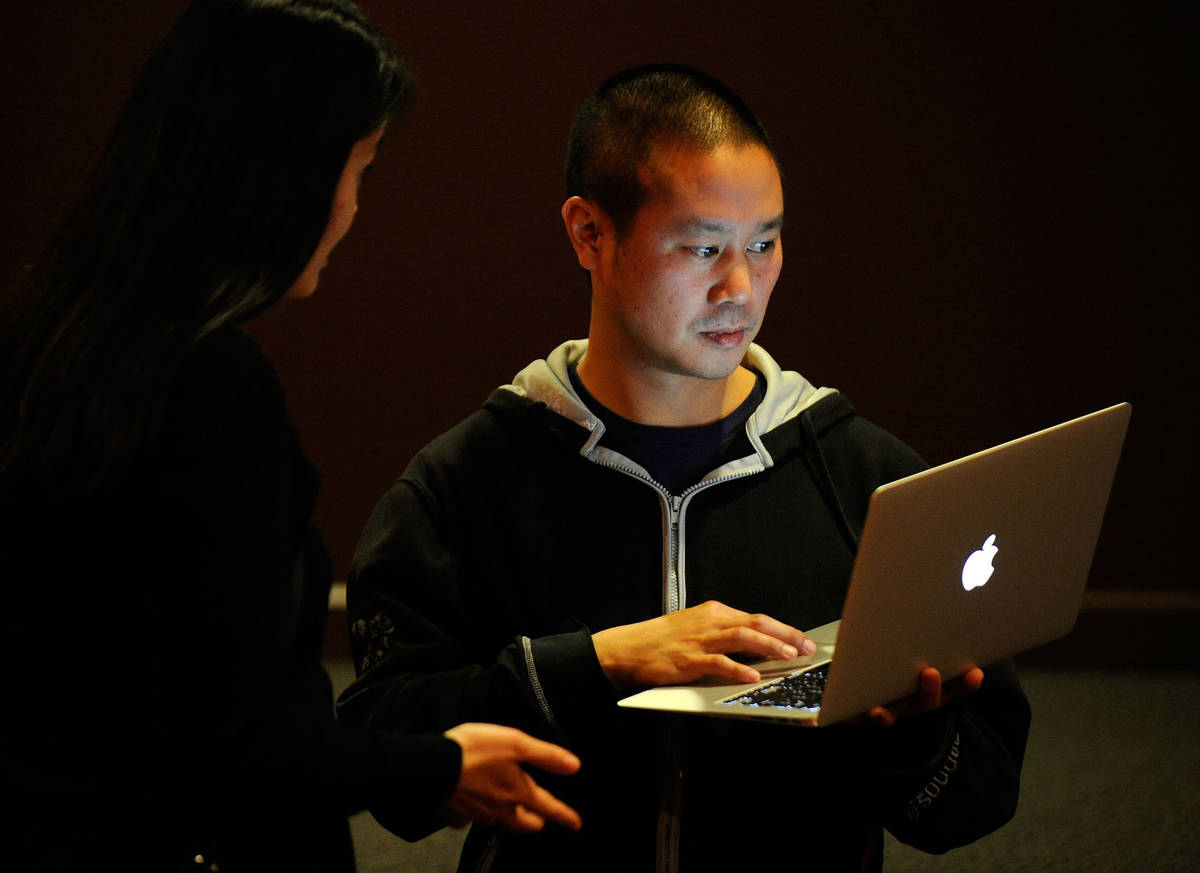 Zappos CEO Tony Hsieh works on his laptop computer before the start of the LaunchUp Las Vegas e ...