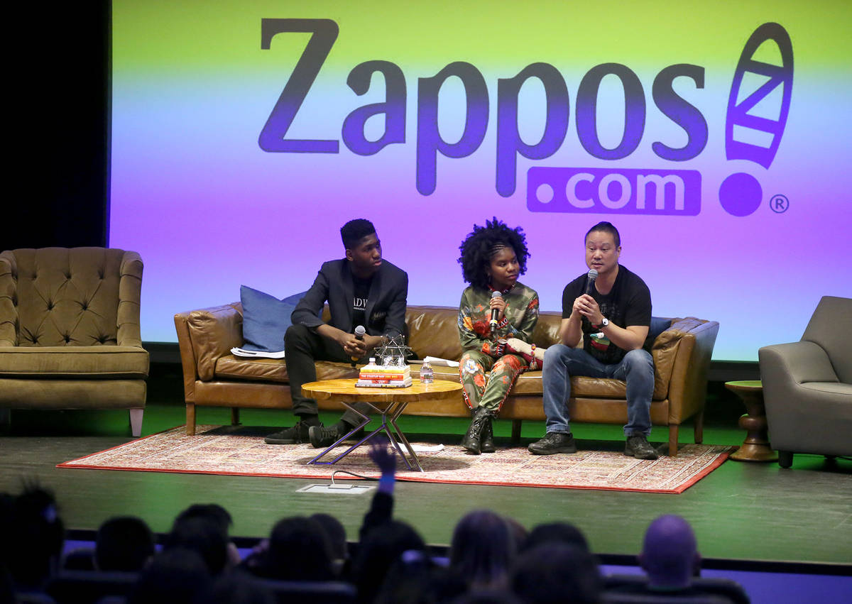 Zappos CEO Tony Hsieh, right, takes questions with Meahel Heard-Pitra, left, and Trinitee Stoke ...