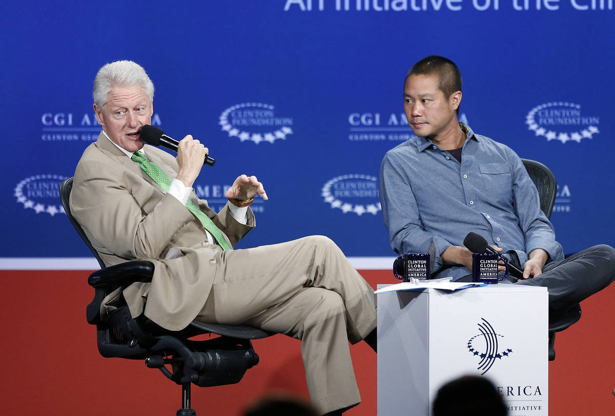 In this June 25, 2014, file photo, former President Bill Clinton, left, speaks with Zappos.com ...