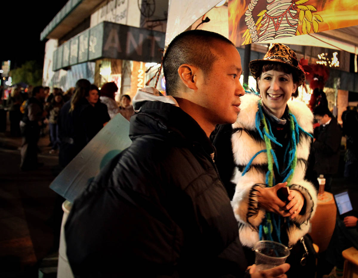 Tony Hsieh, CEO of online clothing retailer Zappos.com, talks to artist Nicki Doran during Firs ...