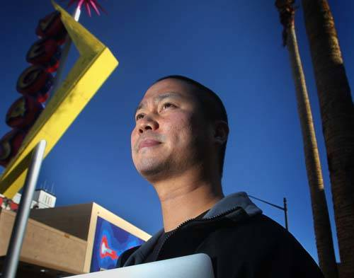 Tony Hsieh, CEO of online clothing retailer Zappos.com, stands near a Vegas neon sign in downto ...