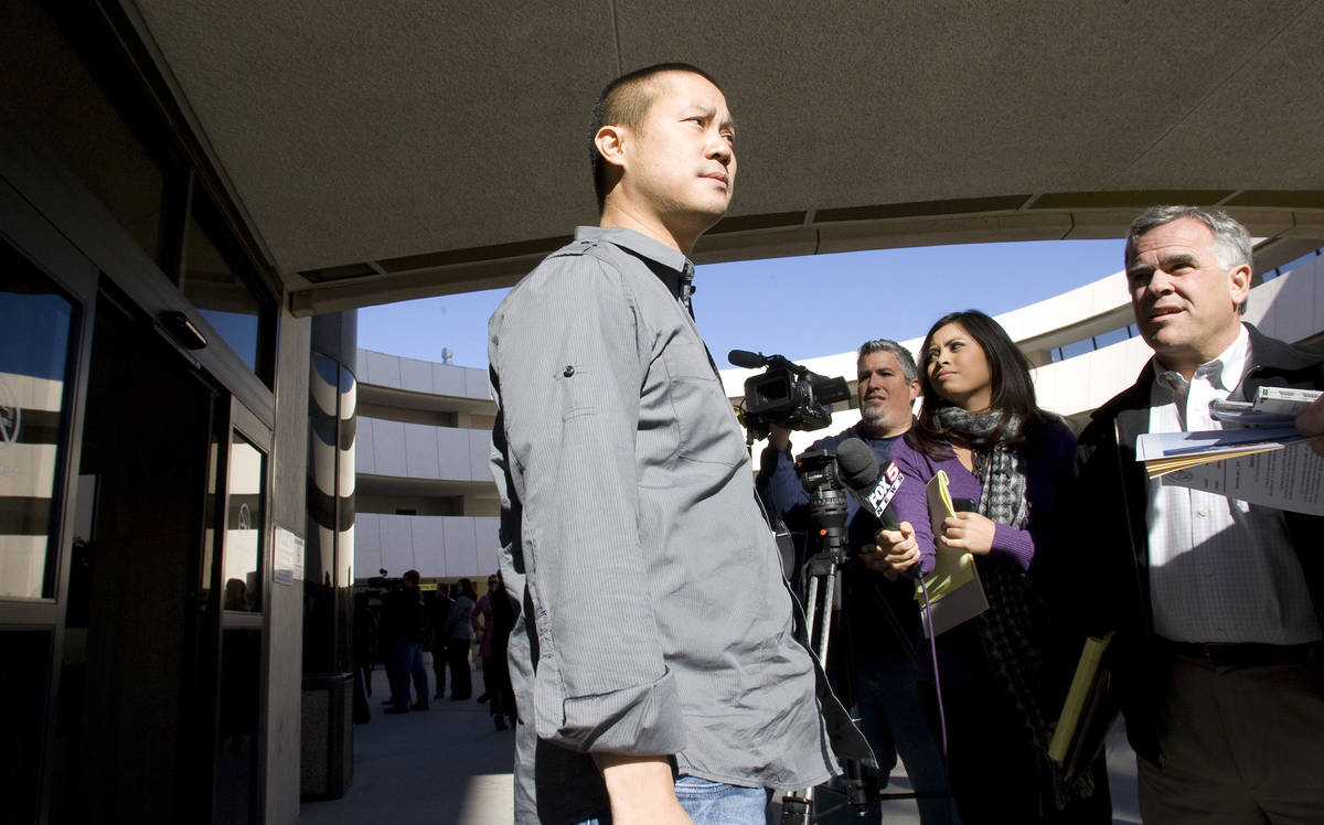 Tony Hsieh, CEO of Zappos a subsidiary of Amazon.com, takes questions as he leaves Las Vegas Ci ...