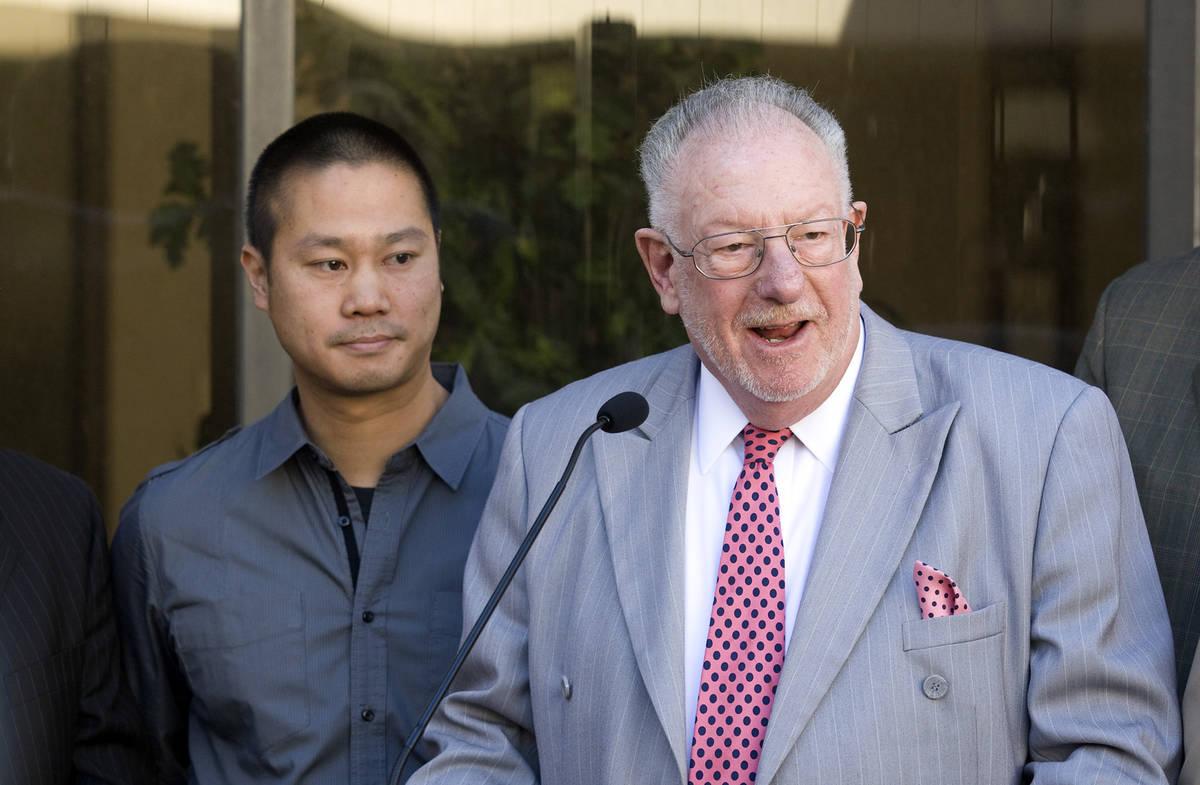 Tony Hsieh, left, CEO of Zappos a subsidiary of Amazon.com, looks on as Las Vegas Mayor Oscar G ...