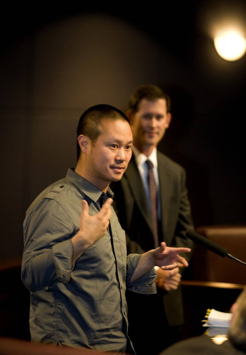 Tony Hsieh, left, CEO of Zappos a subsidiary of Amazon.com, speaks to members of the Las Vegas ...