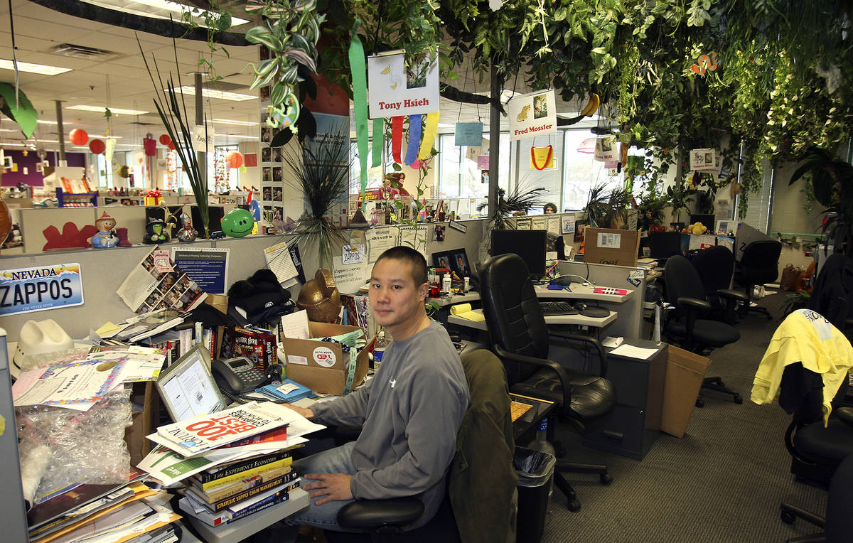 Zappos CEO Tony Hsieh works at his desk in an area called The Jungle, Friday Jan. 23, 2009. ...