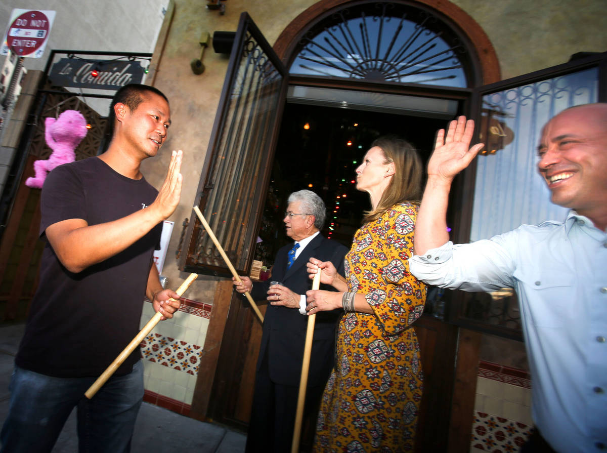 Zappos C.E.O. and downtown Las Vegas developer Tony Hsieh, left, high fives La Comida co-owner ...
