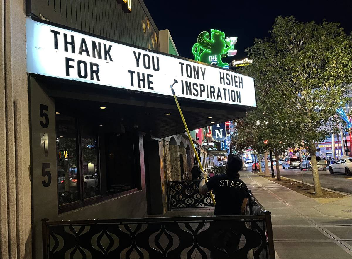 Chris Snook, manager at Corduroy on East Fremont Street, creates a message honoring Tony Hsieh ...