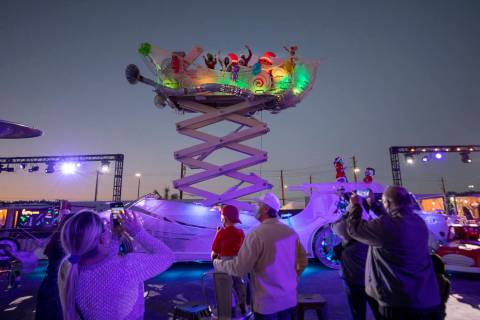 "Toys are thrown to kids from a sleigh during the kick off of ""Wanderland"" holiday experience at ..."