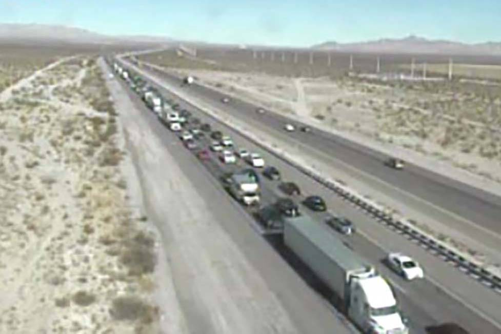 Southbound traffic on Interstate 15 backs up near the Nevada-California border at about 11:40 a ...