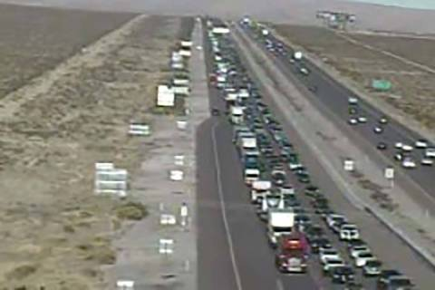Traffic backs up on Interstate 15 southbound near Jean, about 12 miles from the California bord ...