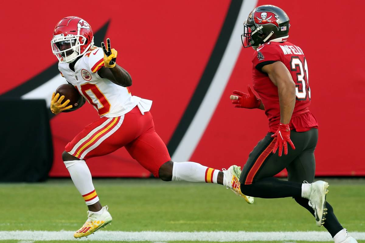 Kansas City Chiefs wide receiver Tyreek Hill (10) reacts as he beats Tampa Bay Buccaneers stron ...
