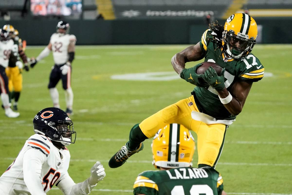 Green Bay Packers' Davante Adams catches a touchdown pass during the first half of an NFL footb ...