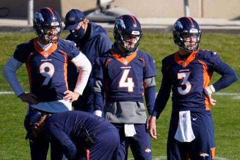 Denver Broncos quarterbacks Drew Lock, Brett Rypien and Jeff Driskel, from right, watch during ...