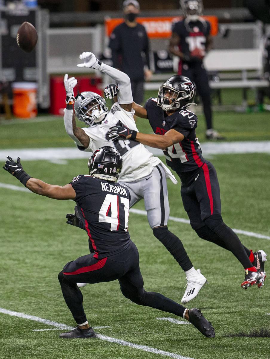 Atlanta Falcons cornerback A.J. Terrell (24) and safety Sharrod Neasman (41) break up a pass in ...