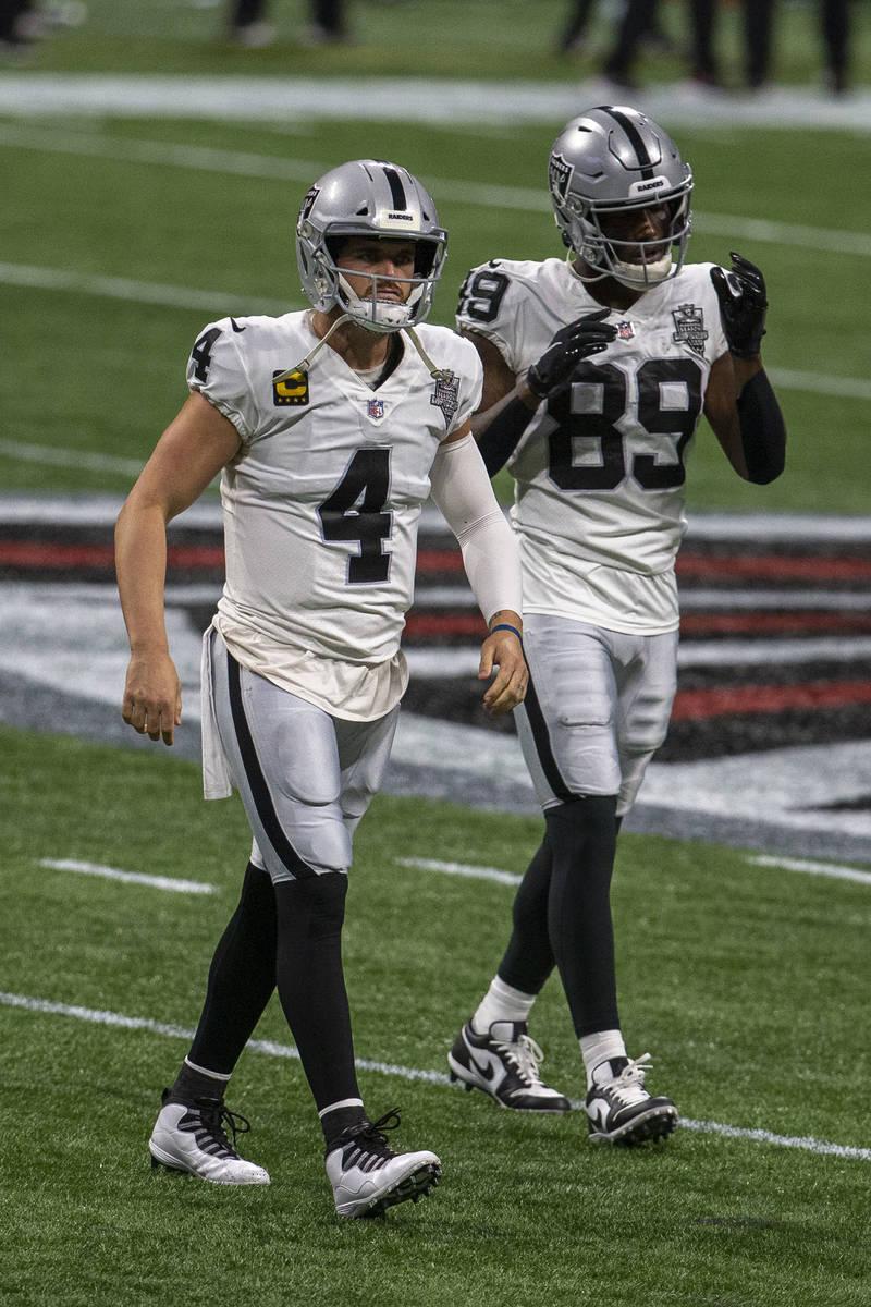 Las Vegas Raiders quarterback Derek Carr (4) and Las Vegas Raiders wide receiver Bryan Edwards ...