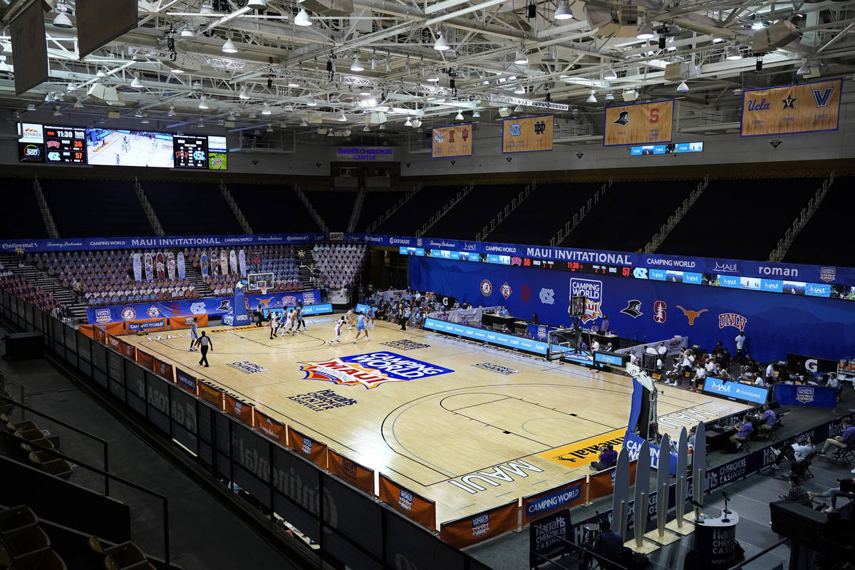 Fans are missing in the stands at Harrah's Cherokee Center during the NCAA college basketball g ...