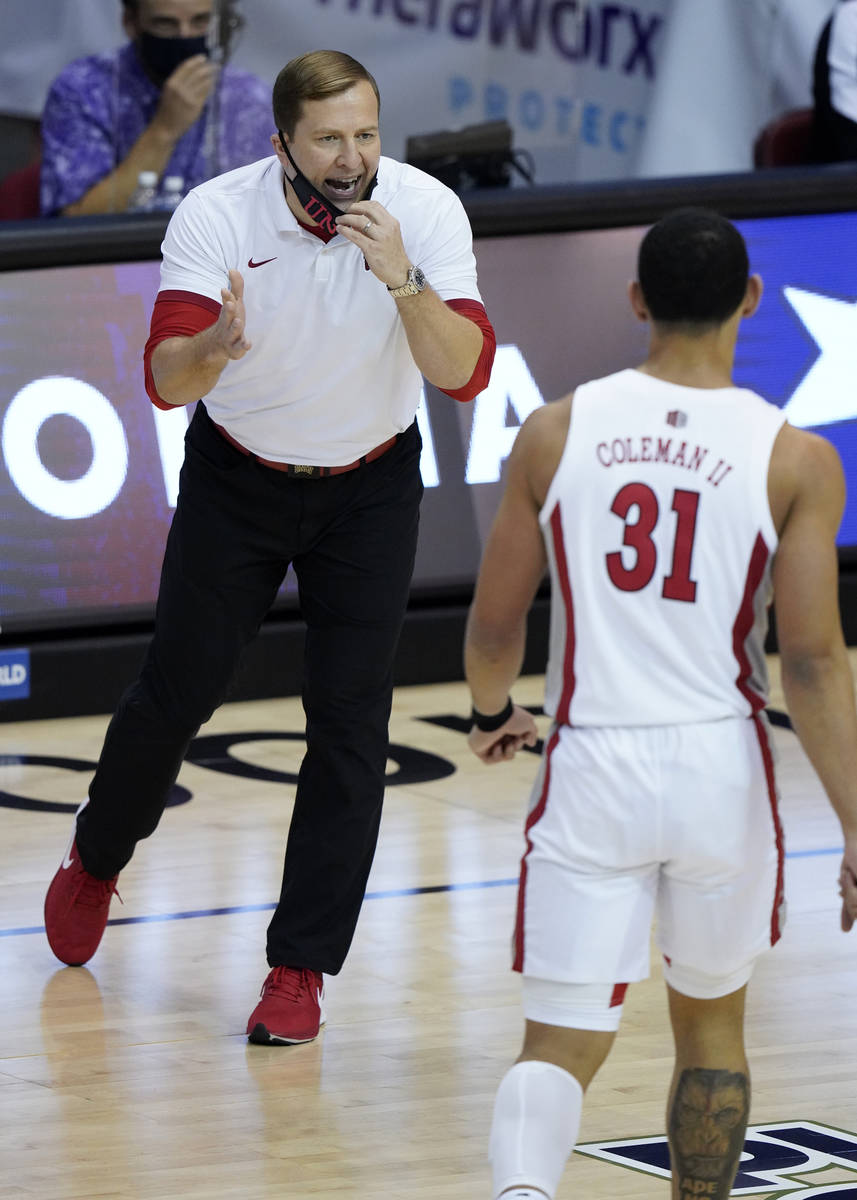 UNLV head coach T.J. Otzelberger, left, directs guard Marvin Coleman (31) in the first half of ...