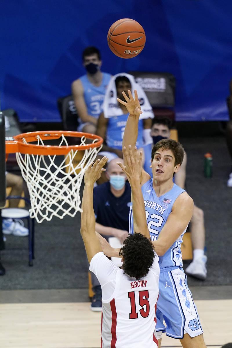 North Carolina forward Walker Miller (22) shoots for the basket over UNLV forward Reece Brown ( ...