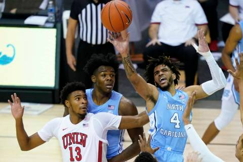 North Carolina guard R.J. Davis (4) leaps to shoot a basket over UNLV guard Bryce Hamilton (13) ...