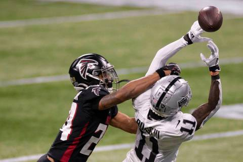 Las Vegas Raiders wide receiver Henry Ruggs III (11) attempts to bring in a catch over Atlanta ...